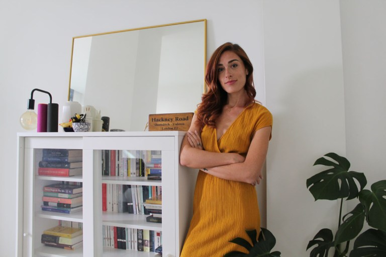 What I Rent: Kelsey, one-bedroom flat in Archway, London - kelsey standing by shelves