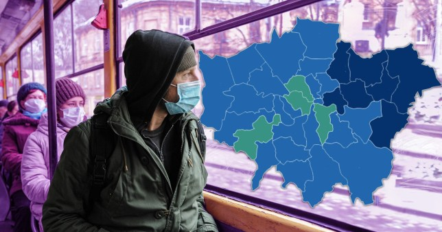 A man sits on a London bus with a face mask on as health leaders warn the city could be heading for tier three
