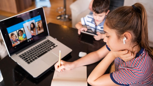 Teenage girl studying with video online lesson at home family in isolation covid-19. Homeschooling and distance learning