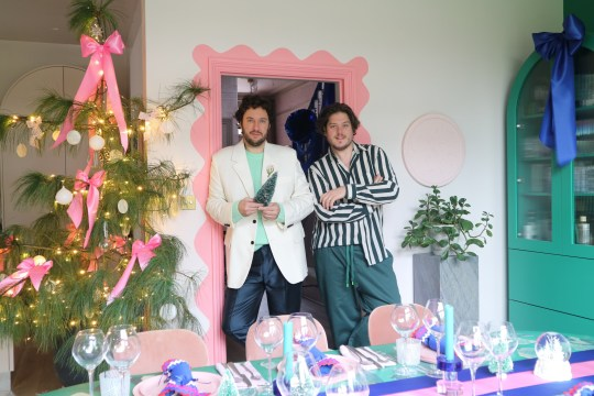 Jordan and Russell from 2LG by their Christmas tree