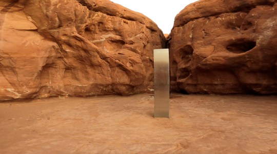 A metal monolith is seen in Red Rock Desert, Utah, U.S., November 25, 2020, in this still image obtained from a social media video. @davidsurber_ via REUTERS ATTENTION EDITORS - THIS IMAGE HAS BEEN SUPPLIED BY A THIRD PARTY. NO RESALES. NO ARCHIVES. MANDATORY CREDIT.