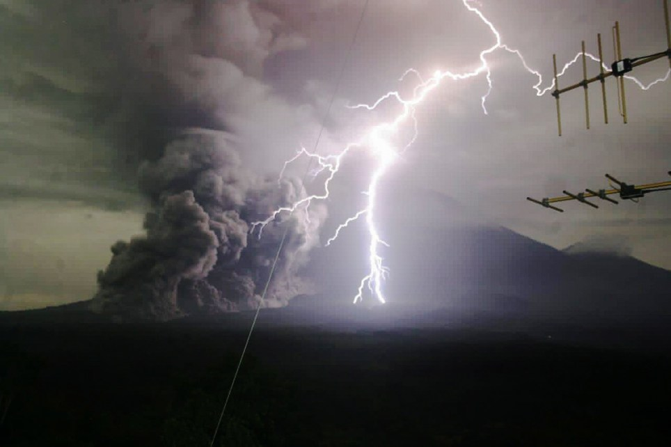 This image from the Indonesian Geological Agency shows lightning striking Mount Semeru as it spews volcanic materials during an eruption in Lumajang, East Java, Indonesia (Credits: EPA)