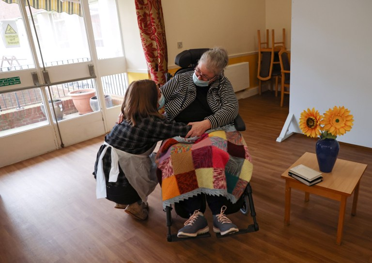 Resident Theresa Snelling hugs her daughter Serena as they are allowed to visit with physical contact for the first time at The Chiswick Nursing Centre, which has introduced a coronavirus disease (COVID-19) test with results ready in thirty minutes, in London, Britain December 2, 2020.