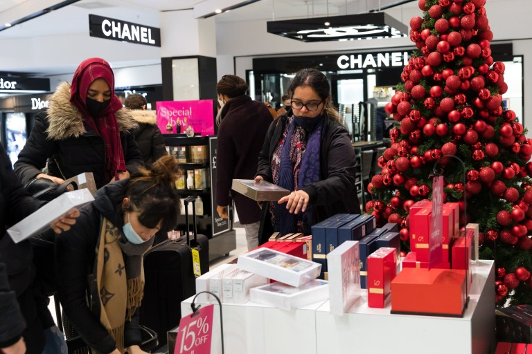 epa08856936 Shoppers buying discounted perfume inside Debenhams in Oxford Street, London, Britain, 02 December 2020. The second Coronavirus UK national lockdown ended on 02 December, allowing non-essential shops to trade ahead of the traditionally busy Christmas season. EPA/VICKIE FLORES