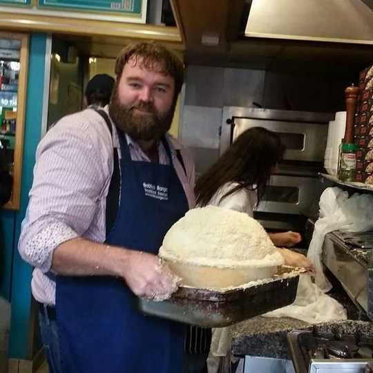 JON FELL / CATERS NEWS - (PICTURED James Taylor - the butcher who made the sausage meat) The creator of the world's biggest scotch egg, has said he doesn't believe the snack counts as a substantial meal - despite creating one that contained a whopping 8000 calories. Jon Fell created the world's largest scotch egg - weighing in at a whopping one stone, seven lbs and packing an incredible 8,000 calories. The creative chef, from Egremont in Cumbria, used a huge ostrich egg flown in from Mexico, as well as one and a half stone of sausage meat, two litres of milk and five loaves of bread to create the mammoth dish. Jon, 48, spent eight hours rustling up the yolky delicacy - which was the size of a beach ball and 18 inches in diameter - and it later took 70 people to devour the lot. SEE CATERS COPY.