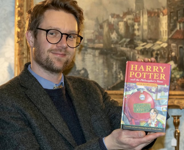Jim Spencer from Hansons with the book. A rare Harry Potter first edition - heading to a car boot sale in a 50p box - could sell for ?50,000 thanks to a stroke of luck. See SWNS story SWMDpotter. And that means one of the best Christmases ever could be on the way for 59-year-old Blackpool mum Karen Rumsey, her bride-to-be daughter Charlotte, 28, from Preston, and sons Callum, 27, a bricklayer now living in Rugby, and IT specialist Cameron, 25, who also lives in Rugby. Charlotte had been helping her mum clear out items in her home when they struck gold ? a first issue hardback copy of Harry Potter and the Philosopher?s Stone, one of only 500 in the first print run published by Bloomsbury in 1997. But they have been so shocked by the discovery Charlotte said they were still pinching themselves: ?Things like this don?t happen to normal families like us. Our friends are delighted for us.? The book is due to be sold by Hansons Auctioneers on December 11, an auction house renowned for uncovering Philosopher?s Stone hardback first editions. The last one it sold in October 2020, posted to its books expert Jim Spencer in a tea towel from Luxembourg, realised a hammer price of ?60,000.