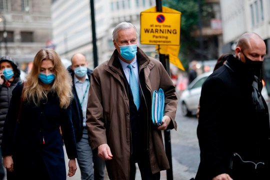 EU chief negotiator Michel Barnier, wearing a protective face covering to combat the spread of the coronavirus, walks to a conference centre in central London on December 4, 2020 as talks continue on a trade deal between the EU and the UK. - With just a month until Britain's post-Brexit future begins and trade talks with the European Union still deadlocked, the UK government on Tuesday urged firms to prepare as it scrambles to finish essential infrastructure. (Photo by Tolga Akmen / AFP) (Photo by TOLGA AKMEN/AFP via Getty Images)