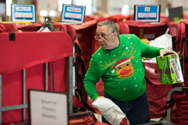 LLANTRISANT, WALES - DECEMBER 16: Mail workers process mail at the Royal Mail Christmas sorting office in Llantrisant on December 16, 2016 in Llantrisant, Wales. Hundreds of temporary workers are employed over the Christmas period to process the increased volume of mail. (Photo by Matthew Horwood/Getty Images)