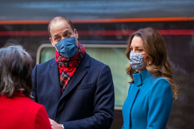 The Duke and Duchess of Cambridge are met by Deputy Lord Lieutenant Sandra Cumming as they arrive by train at Edinburgh Waverley Station on the second day of a three-day tour across the country. PA Photo. Picture date: Monday December 7, 2020. During the tour William and Kate will visit communities, outstanding individuals and key workers to thank them for their efforts during the coronavirus pandemic. See PA story ROYAL Train. Photo credit should read: Andy Barr/PA Wire