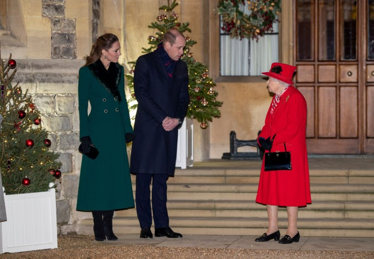 Queen Elizabeth II speaks to Prince William and Kate