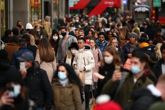 Shoppers walk along a busy Oxford Street in London on December 5
