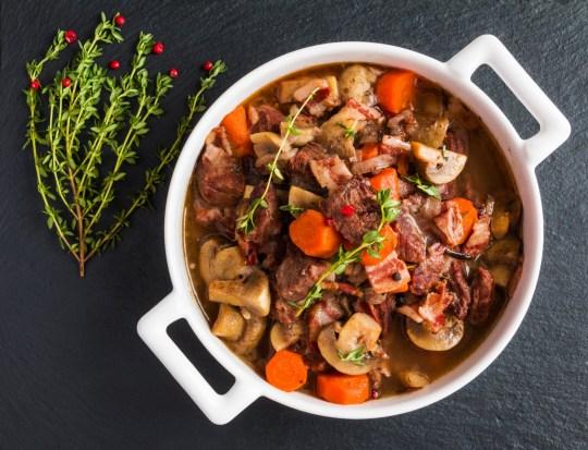 Beef Bourguignon in a casserole on black stone