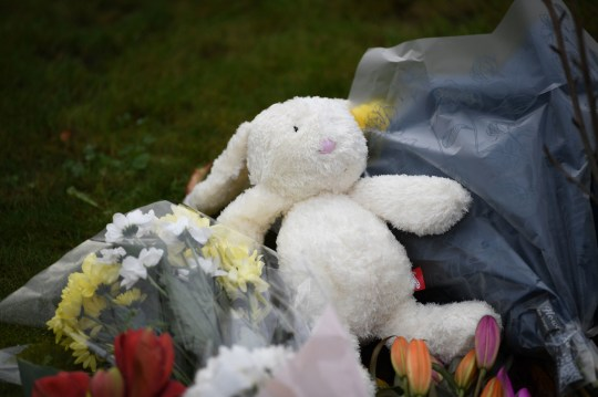 A cuddly toy left with tributes at the scene of a house fire on Buttercup Avenue, Eynesbury, Cambridgeshire, in which a three-year-old boy and a seven-year-old girl died. A 35-year-old woman and a 46-year-old were also injured in the fire at the three-storey house, which police believe broke out around 7am Thursday morning. PA Photo. Picture date: Friday December 11, 2020. See PA story POLICE Eynesbury. Photo credit should read: Joe Giddens/PA Wire