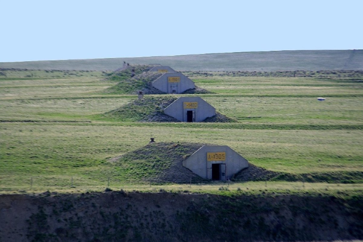 Doomsday bunkers in a field