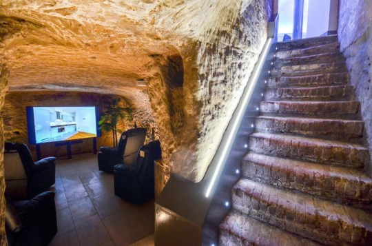 a cave in a flat that woubles up as a cinema