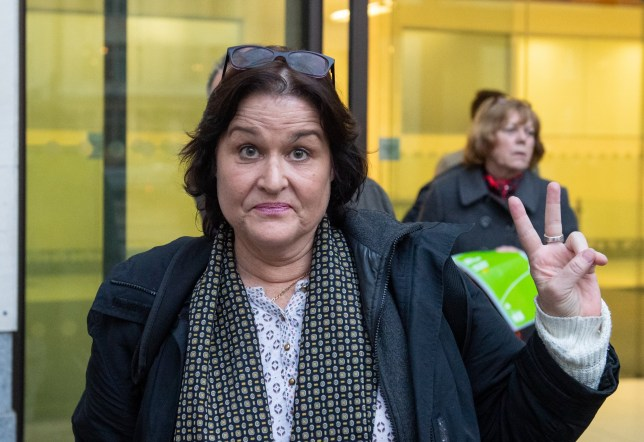 Amy Beth Dalla Mura gestures as she leaves Westminster Magistrates' Court, London, where she is appearing on charges of harrassment against Anna Soubry.