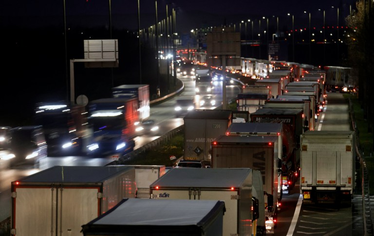 Trucks queue on the A16 highway between Eurotunnel road access and Oye Plage, northern France, as Britain is set to leave the European Union's orbit in about two weeks, December 18, 2020. REUTERS/Pascal Rossignol