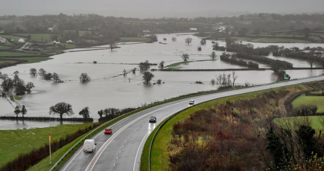 Flooded fields as the River Towy bursts its banks in Carmarthenshire after the Met Office warned that torrential rain is expected to cause flooding in some parts of the UK.