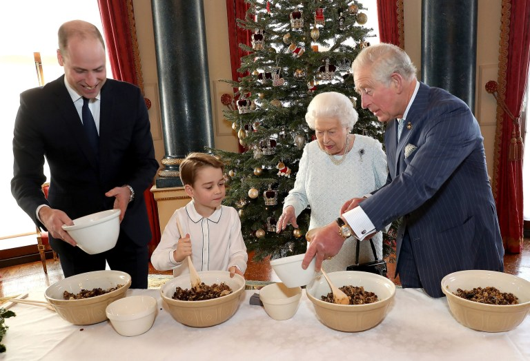 Prince William, Prince George, the Queen and Prince Charles mix a Christmas pudding