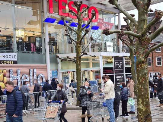 Customers queue outside a Tesco supermarket amid the coronavirus disease (COVID-19) outbreak in London, Britain December 21, 2020 in this picture obtained from social media. Mark Hall/via REUTERS THIS IMAGE HAS BEEN SUPPLIED BY A THIRD PARTY. MANDATORY CREDIT. NO RESALES. NO ARCHIVES.