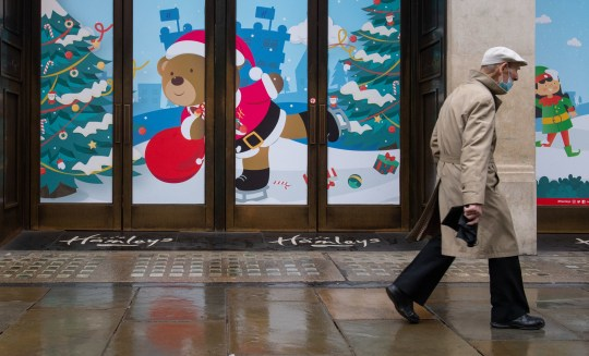 A man walks past closed shops on Regent Street, London. Prime Minister Boris Johnson cancelled Christmas for almost 18 million people across London and eastern and south-east England following warnings from scientists of the rapid spread of the new variant of coronavirus. PA Photo. Picture date: Monday December 21, 2020. See PA story HEALTH Coronavirus. Photo credit should read: Dominic Lipinski/PA Wire