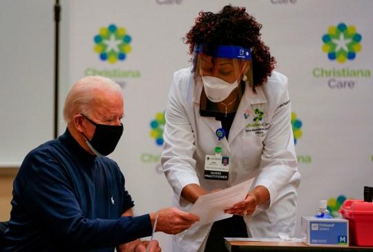 Joe Biden reads explainer document before having his Covid vaccine
