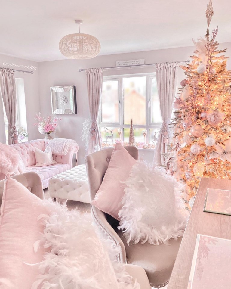 pink living room with christmas tree