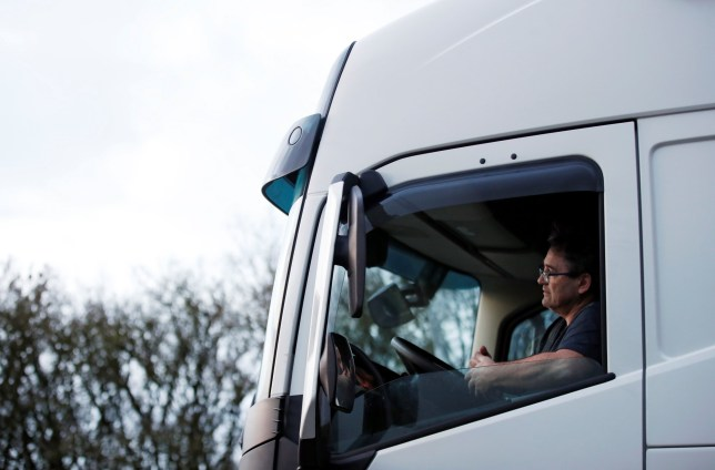 Lorry driver Antonio from Spain waits to join the M20 motorway, as EU countries impose a travel ban from the UK following the coronavirus disease (COVID-19) outbreak, near Folkestone, Britain, December 22, 2020. REUTERS/Peter Cziborra