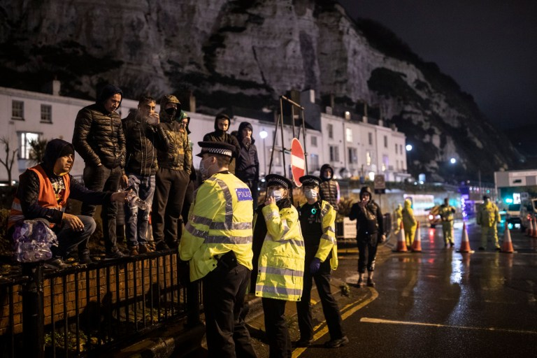 Police and drivers speak at the entry to the port on December 22, 2020 in Dover, England.