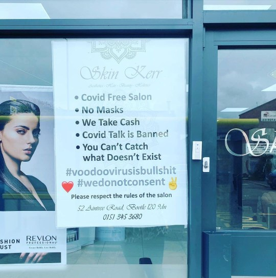 The Covid-denying poster outside Skin Kerr in Bootle (Picture: @skinkerr_)
