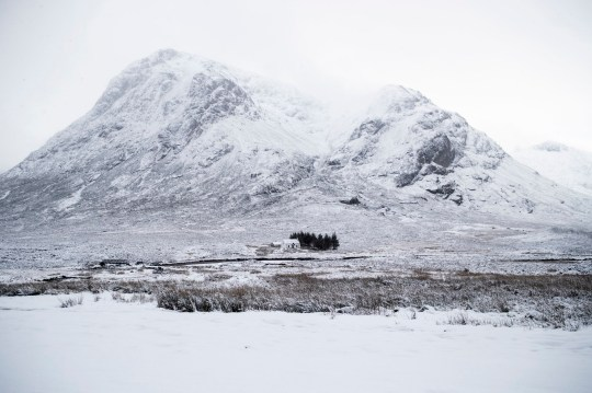 Fresh snow covers Buachaille Etive Mor in Glencoe, Scotland. PA Photo. Picture date: Sunday December 27, 2020. Storm Bella continues to bring severe gales and heavy rain to the UK and Ireland with winds of up to 70mph in exposed coastal locations of the UK and with heavy rainfall in Wales and south-west England. See PA story WEATHER Bella. Photo credit should read: Jane Barlow/PA Wire