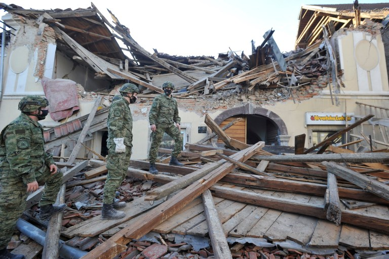 Soldiers inspect remains of a building damaged in an earthquake, in Petrinja, Croatia, Tuesday, Dec. 29, 2020. A strong earthquake has hit central Croatia and caused major damage and at least one death in a town southeast of the capital. (AP Photo)