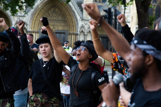 Sasha Johnson (C) from the Rhodes Must Fall campaign seen making gestures along with other protesters while shouting slogans at parliament square during a demonstration. Six weeks after the death of George Floyd in the US Black Lives Matter protests continue in London. (Photo by Thabo Jaiyesimi / SOPA Images/Sipa USA)