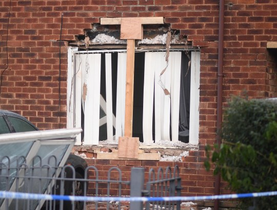 A man has been arrested on suspicion of attempted murder after a girl and a woman were taken to hospital following an explosion at a home. The girl, aged 11, and a woman, aged 32, were taken to hospital as a 'precaution' following the incident in Wythenshawe, a GMP spokesman said. Police were called to Pewsey Road today (Wednesday) at around 12.20am after the sound of a bang was heard by neighbours. CAPTION House explosion on Pewsey Rd , Wythenshawe , Manchester . 30 December 2020