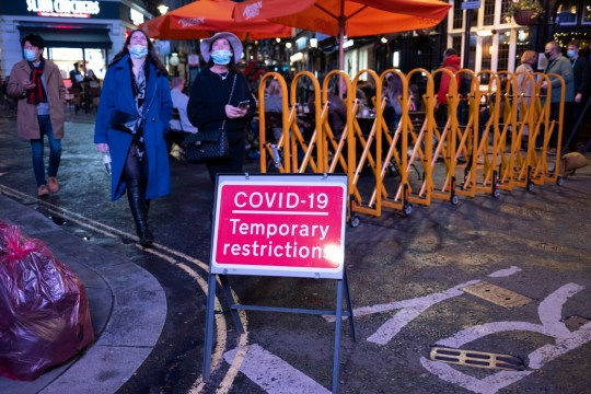 As Londoners await the announcement of a second coronavirus lockdown it's business as usual in the West End with people out socialising outside the bars and restaurants on Old Compton Street in Soho on what will be the last weekend before a month-long total lockdown in the UK on 31st October 2020 in London, United Kingdom. The three tier system in the UK has not worked sufficiently, to suppress the virus, and there have have been calls by politicians for a 'circuit breaker' complete lockdown to be announced to help the growing spread of the Covid-19. (photo by Mike Kemp/In Pictures via Getty Images)