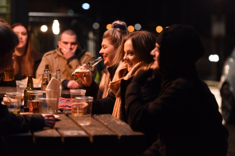 Revellers enjoy a night out in Exeter before it moves to tier three