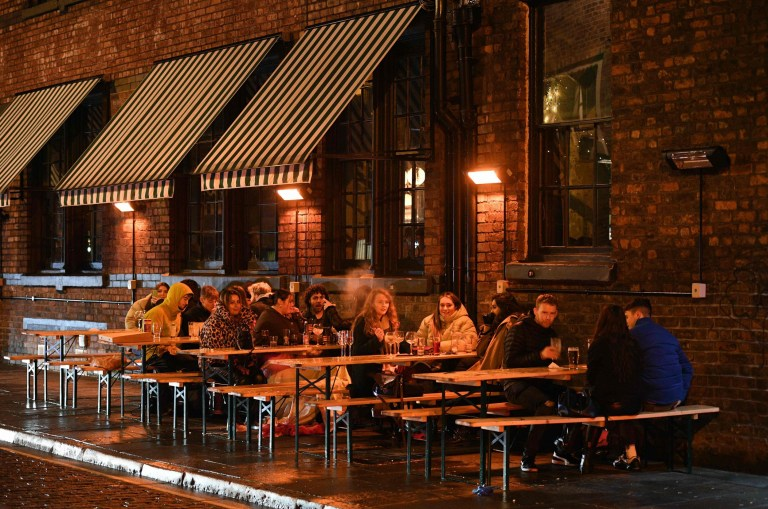 Revellers enjoy a night out in central Liverpool before it moves to tier three