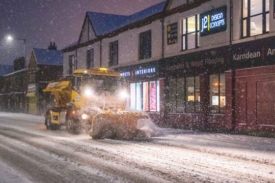 MERCURY PRESS. 31/12/20. Horwich, UK. (Pictured: A gritter with a plow drives down Chorley New Road in Horwich, Gtr Manchester, this morning [THURS]. Almost 5 inches of snow has fallen overnight in the town of Horwich in Greater Manchester. Travel warnings are in place across the county, despite it moving into Tier 4 today.)