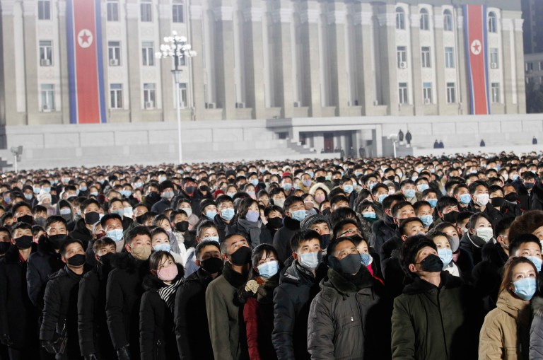 People watch the national flag raising ceremony and fireworks display to celebrate the New Year, at Kim Il Sung Square in Pyongyang, North Korea