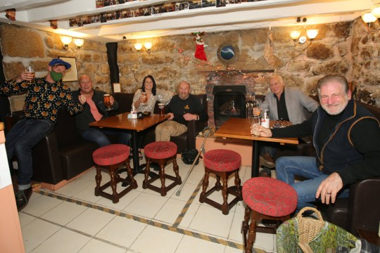 NYE celebrations at Jack's Bar on St Mary's, Isle Of Scilly. Lucky revellers in Britain???s only Tier 1 area toasted the New Year in pubs ??? but still had to go home before midnight. Scilly Isles locals were the sole Brits able to hit bars for celebrations.