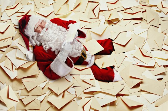 Santa on a pile of letters