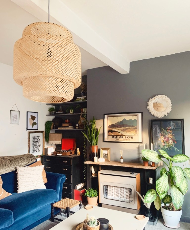 What I Rent: Sally, £600 a month for a two-bedroom flat in Edinburgh - living room with blue sofa and faux fireplace