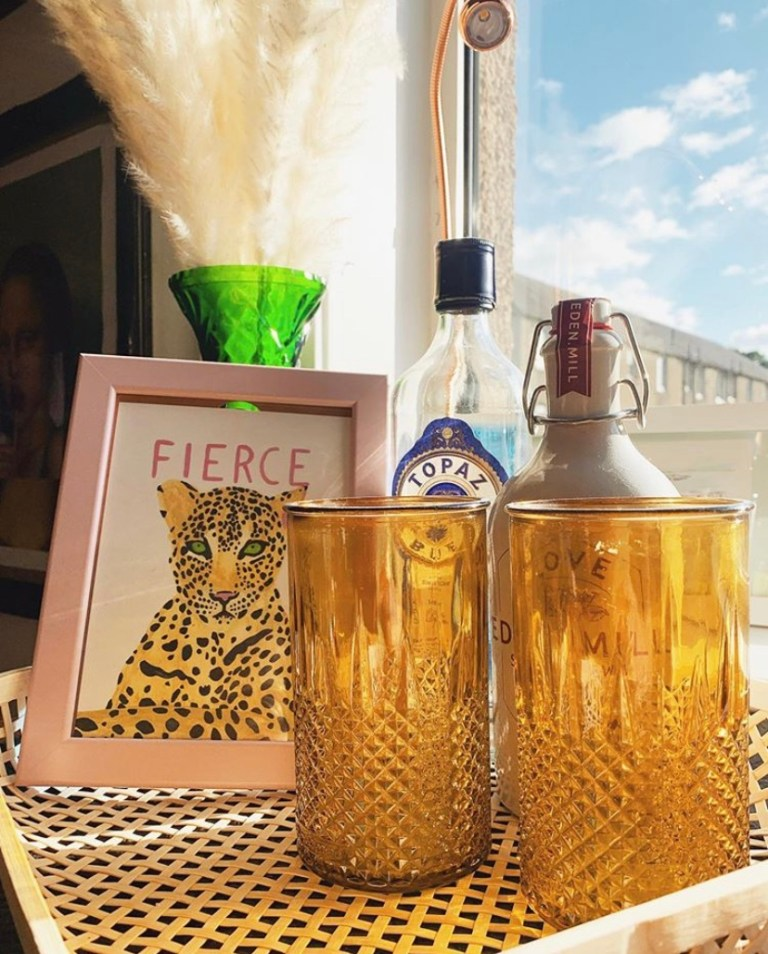 What I Rent: Sally, £600 a month for a two-bedroom flat in Edinburgh - bar cart: alcohol, picture of a leopard, and glasses