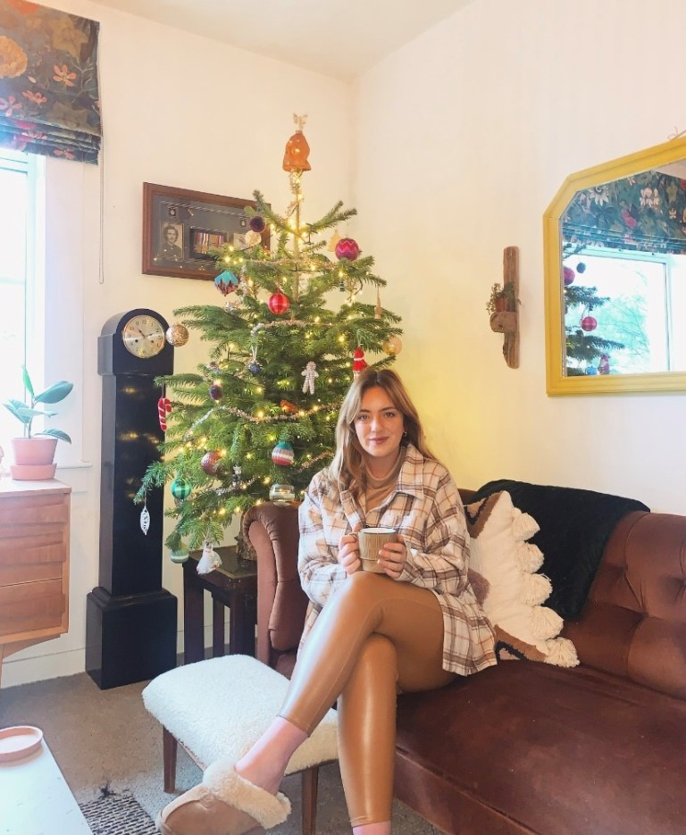 What I Rent: Sally, £600 a month for a two-bedroom flat in Edinburgh - sally in her living room next to her christmas tree