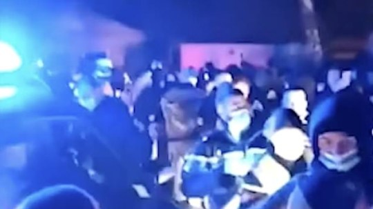 Brits attend 2,500-strong NYE rave where revellers set police car on fire