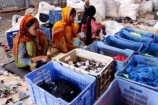 Workers sorting through garment waste