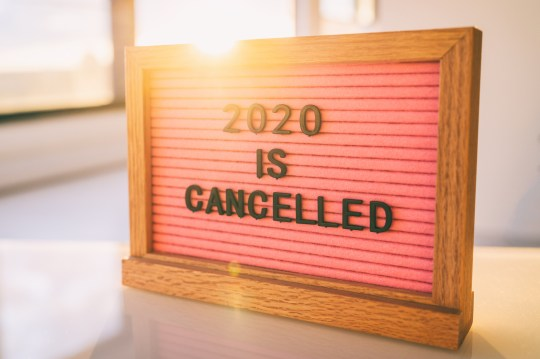 Funny Quote on pink felt sign board: 2020 IS CANCELLED message at home.