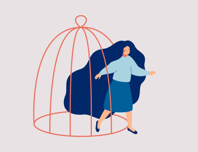 A young woman steps out of the cage. The female character is getting out of a confined space.