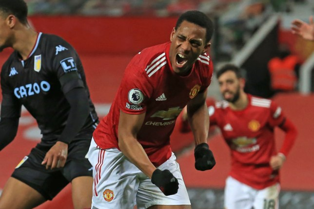 Manchester United's French striker Anthony Martial (C) celebrates after scoring the opening goal during the English Premier League football match between Manchester United and Aston Villa at Old Trafford in Manchester, north west England, on January 1, 2021.