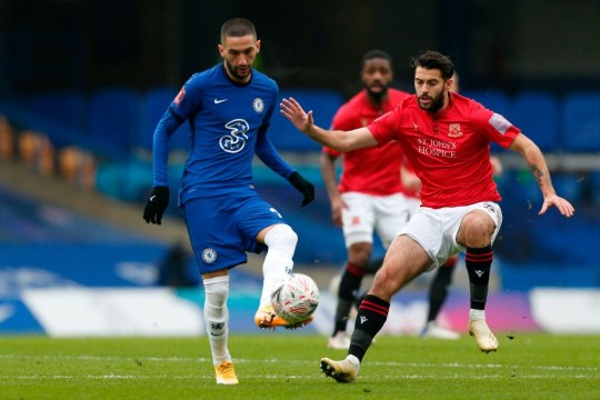 Hakim Ziyech runs with the ball during Chelsea's win over Morecambe